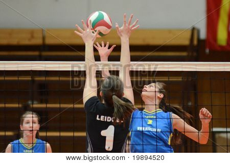 KAPOSVAR, HUNGARY - JANUARY 23: Zsofia Harmath (R) in action at the Hungarian NB I. League woman volleyball game Kaposvar vs Miskolc, January 23, 2011 in Kaposvar, Hungary.