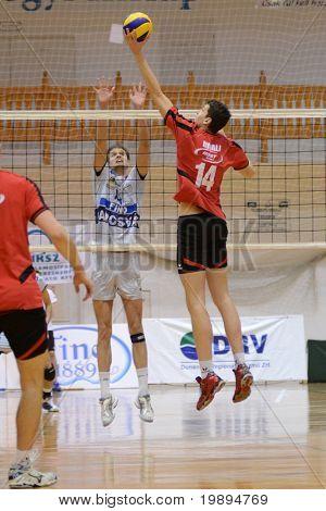 KAPOSVAR, HUNGARY - JANUARY 28: Krisztian Csoma (C) blocks the ball at a Middle European League volleyball game Kaposvar (HUN) vs. Mladost Zagreb (CRO), on January 28, 2011 in Kaposvar, Hungary.