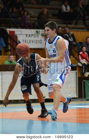 KAPOSVAR, HUNGARY - JANUARY 26: Gergely Kutasi (R) in action at a Hugarian Cup basketball game Kaposvar vs. Szeged January 26, 2011 in Kaposvar, Hungary.