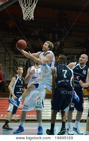 KAPOSVAR, HUNGARY - JANUARY 26: Joshua Wilson (with the ball) in action at a Hugarian Cup basketball game Kaposvar vs. Szeged January 26, 2011 in Kaposvar, Hungary.