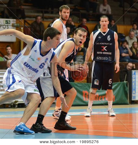 KAPOSVAR, HUNGARY - JANUARY 26: Gergely Kutasi (L) in action at a Hugarian Cup basketball game Kaposvar vs. Szeged January 26, 2011 in Kaposvar, Hungary.