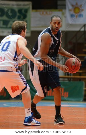 KAPOSVAR, HUNGARY - JANUARY 26: Joshua Wilson (L) in action at a Hugarian Cup basketball game Kaposvar vs. Szeged January 26, 2011 in Kaposvar, Hungary.