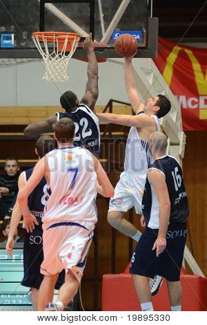 KAPOSVAR, HUNGARY - JANUARY 26: Gabor Soos (2nd from R) in action at a Hugarian Cup basketball game Kaposvar vs. Szeged January 26, 2011 in Kaposvar, Hungary.