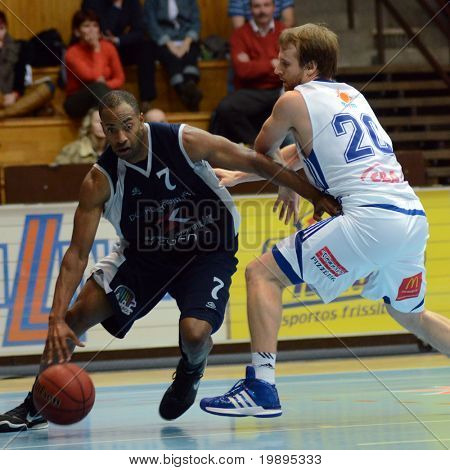 KAPOSVAR, HUNGARY - JANUARY 26: Joshua Wilson (R) in action at a Hugarian Cup basketball game Kaposvar vs. Szeged January 26, 2011 in Kaposvar, Hungary.