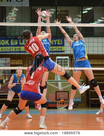 KAPOSVAR, HUNGARY - FEBRUARY 4: Barbara Balajcza (R) blocks the ball at the Hungarian NB I. League woman volleyball game Kaposvar vs Szolnok, February 4, 2011 in Kaposvar, Hungary.
