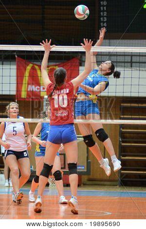 KAPOSVAR, HUNGARY - FEBRUARY 4: Balajcza Barbara (R) strikes the ball at the Hungarian NB I. League woman volleyball game Kaposvar vs Szolnok, February 4, 2011 in Kaposvar, Hungary.