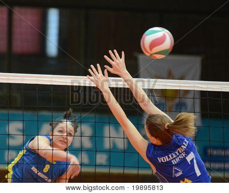 KAPOSVAR, HUNGARY - FEBRUARY 13: Barbara Balajcza (L) strikes the ball at the Hungarian NB I. League woman volleyball game Kaposvar vs Bekescsaba, February 13, 2011 in Kaposvar, Hungary.