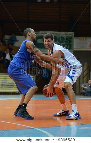 KAPOSVAR, HUNGARY - FEBRUARY 26: Daniel Werner (in white) in action at a Hungarian National Championship basketball game Kaposvar vs Albacomp on February 26, 2011 in Kaposvar.
