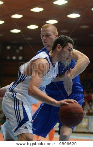 KAPOSVAR, HUNGARY - FEBRUARY 26: Unidentified players in action at a Hungarian National Championship basketball game Kaposvar vs Albacomp on February 26, 2011 in Kaposvar, Hungary.