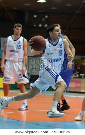 KAPOSVAR, HUNGARY - FEBRUARY 26: Tamas Markus (9) in action at a Hungarian National Championship basketball game Kaposvar vs Albacomp on February 26, 2011 in Kaposvar, Hungary.
