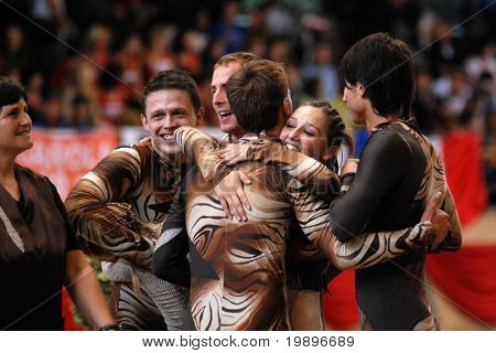 KAPOSVAR, HUNGARY - AUGUST 12: Slovakian competitors celebrate at the Vaulting World Championship Final on August 12, 2007 in Kaposvar, Hungary.
