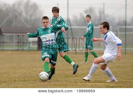KAPOSVAR, HUNGARY - MARCH 5: Krisztian Garai (10) in action at the Hungarian National Championship under 19 game between Kaposvar and MTK on March 5, 2011 in Kaposvar, Hungary.