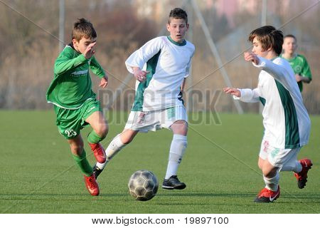 KAPOSVAR, HUNGARY - MARCH 9: Patrik Lukacs (L) in action at the Hungarian National Championship under 13 game between Kaposvar and Airnergy FC on March 9, 2011 in Kaposvar, Hungary.