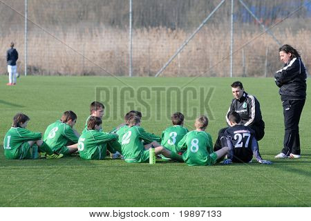 KAPOSVAR, HUNGARY - MARCH 9: Airnergy players listen to their trainer at the Hungarian National Championship under 13 game between Kaposvar and Airnergy FC on March 9, 2011 in Kaposvar, Hungary.