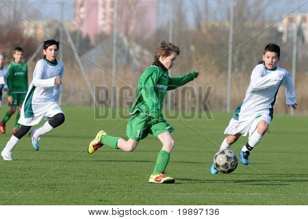 KAPOSVAR, HUNGARY - MARCH 9: Attila Berki (C) in action at the Hungarian National Championship under 13 game between Kaposvar and Airnergy FC on March 9, 2011 in Kaposvar, Hungary.