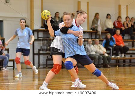 KAPOSVAR, HUNGARY - MARCH 13: Bernadett Sardi (with the ball) in action at Hungarian Handball National Championship III. match (Kaposvar vs. Kormend) March 13, 2011 in Kaposvar, Hungary.