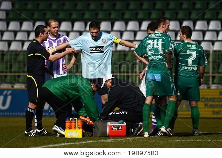 KAPOSVAR, HUNGARY - MARCH 16: Szabolcs Balajcza (in blue) in action at a Hungarian National Cup soccer game - Kaposvar vs Ujpest on March 16, 2011 in Kaposvar, Hungary.