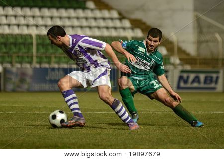 KAPOSVAR, HUNGARY - MARCH 16: Pedro Sass (in green) in action at a Hungarian National Cup soccer game - Kaposvar vs Ujpest on March 16, 2011 in Kaposvar, Hungary.