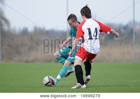 KAPOSVAR, HUNGARY - MARCH 13:Patrik Stangli (in green) in action at the Hungarian National Championship under 19 game between Kaposvar and Mohacs on March 13, 2011 in Kaposvar, Hungary.
