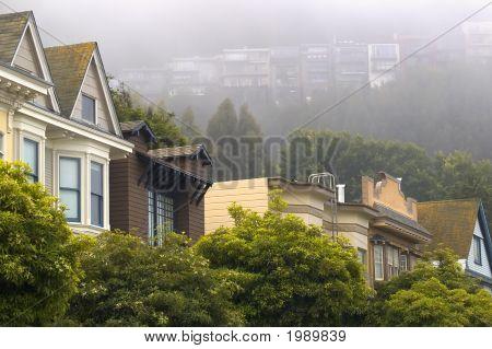 Street And Foggy Hillside