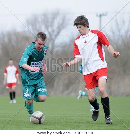 KAPOSVAR, HUNGARY - MARCH 13: Patrik Stangli (in green) in action at the Hungarian National Championship under 19 game between Kaposvar and Mohacs on March 13, 2011 in Kaposvar, Hungary.