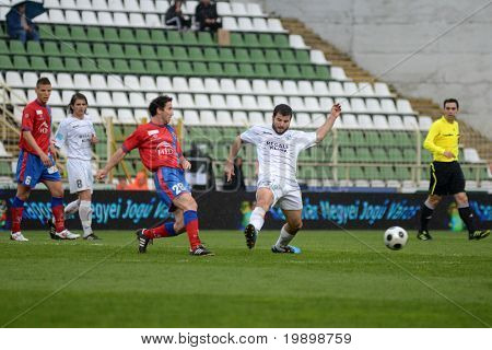 KAPOSVAR, HUNGARY - APRIL 1: Pedro Sass (2nd from R) in action at a Hungarian National Championship soccer game - Kaposvar vs Vasas on April 1, 2011 in Kaposvar, Hungary.