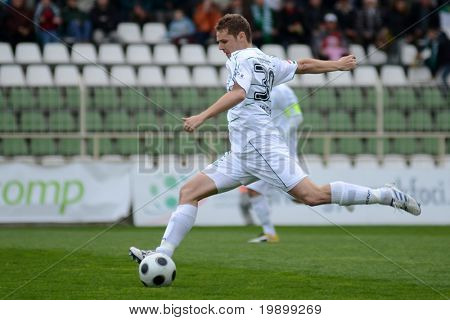 KAPOSVAR, HUNGARY - APRIL 16: Mihaly Korhut (in white) in action at a Hungarian National Championship soccer game - Kaposvar vs MTK Budapest on April 16, 2011 in Kaposvar, Hungary.