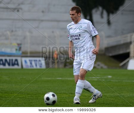 KAPOSVAR, HUNGARY - APRIL 16: Unidentified player in action at a Hungarian National Championship soccer game - Kaposvar vs MTK Budapest on April 16, 2011 in Kaposvar, Hungary.