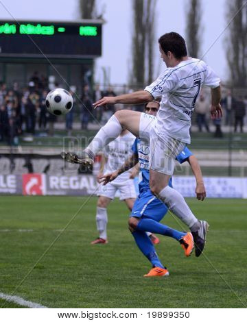 KAPOSVAR, HUNGARY - APRIL 16: Boris Gujic (in white) in action at a Hungarian National Championship soccer game - Kaposvar vs MTK Budapest on April 16, 2011 in Kaposvar, Hungary.