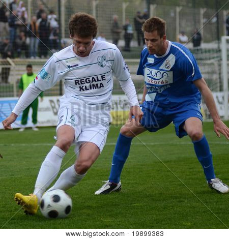 KAPOSVAR, HUNGARY - APRIL 16: Milan Peric (L) in action at a Hungarian National Championship soccer game - Kaposvar vs MTK Budapest on April 16, 2011 in Kaposvar, Hungary.
