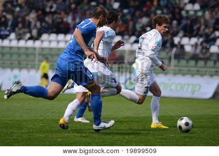 KAPOSVAR, HUNGARY - APRIL 16: Lorant Olah (C) in action at a Hungarian National Championship soccer game - Kaposvar vs MTK Budapest on April 16, 2011 in Kaposvar, Hungary.