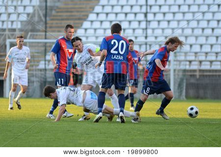 KAPOSVAR, HUNGARY - APRIL 27: Bojan Pavlovic (in white) in action at aHungarian National Cup soccer game Kaposvar vs Videoton April 27, 2011 in Kaposvar, Hungary.