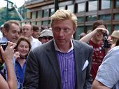 WIMBLEDON, ENGLAND - JUNE 24: Former tennis champion Boris Becker walks through the crowds at Wimble