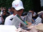 WIMBLEDON, ENGLAND, JUNE 24: Rapha Nadal signing autographs for fans at the Wimbledon Lawn Tennis Ch
