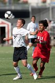 NORTHRIDGE, CA. - AUGUST 28: Devin Deldo (L) chest traps the ball in front of Mike Mota (R) during t