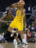 LOS ANGELES, CA. - SEPTEMBER 16: Tina Thompson (R) trying to get past Swin Cash (L) during the WNBA