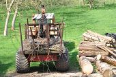 pic of farmworker  - A tractor with a trailer - JPG