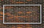 stock photo of arriere-plan  - Rectangular metal frame on a brick wall - JPG