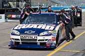AVONDALE, AZ - APRIL 10: The pit crew pushes the #88 National Guard car, driven by Dale Earnhardt Jr