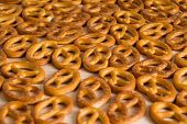 Background Texture Of Salted Savory Mini Pretzels In The Traditional Looped Knot Shape. Top View Ful poster