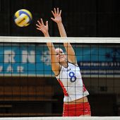 KAPOSVAR, HUNGARY - JANUARY 10: Kornyei blocks the ball at the Hungarian NB I. League woman volleyba