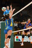 KAPOSVAR, HUNGARY - DECEMBER 19: Barbara Balajcza (C) blocks the ball at the Hungarian NB I. League