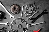 Bicycle parts and repair tools on gray background poster