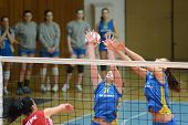 KAPOSVAR, HUNGARY - FEBRUARY 4: Barbara Balajcza (C) blocks the ball at the Hungarian NB I. League w