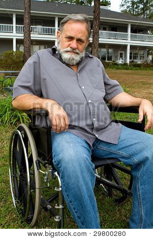 Cripple In Wheelchair