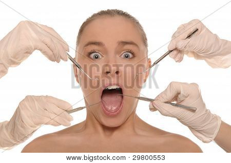frightened woman on reception at the dentist's