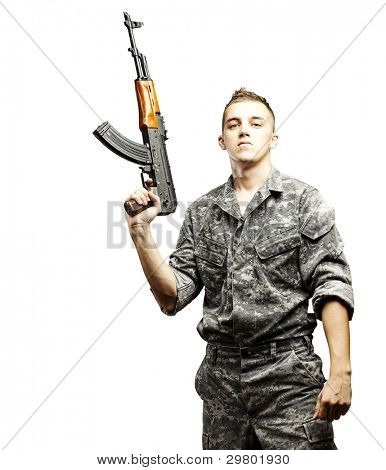 portrait of young soldier holding rifle wearing urban camouflage over white background