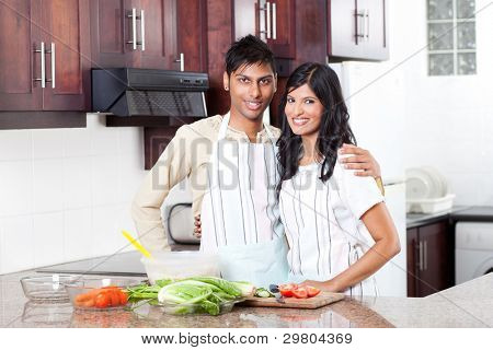 happy young indian couple portrait in kitchen
