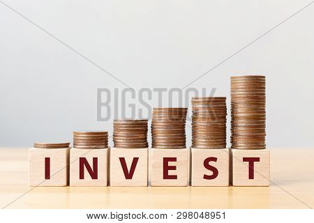poster of Money Coins Stack Stair As Step Growing Growth And Wooden Cube Block With Word Invest. Investment An