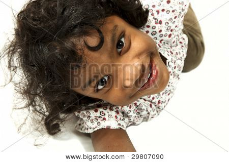 Portrait of sweet Indian girl, top view, isolated on white background